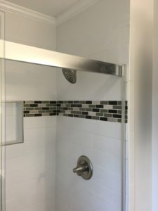 Mosaic tile accent on subway tile shower